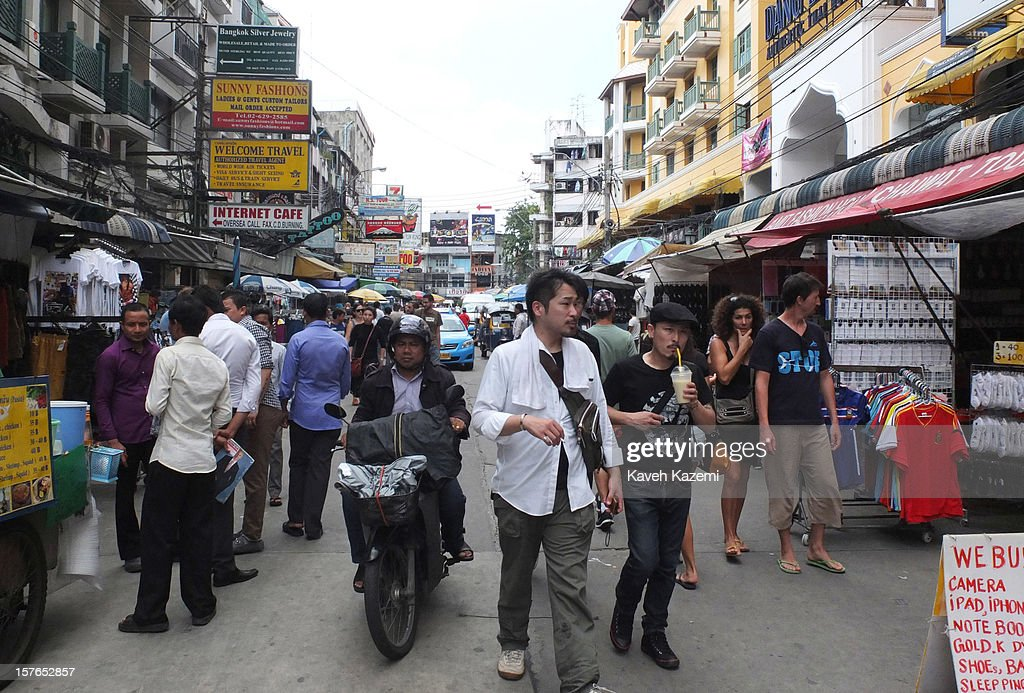People engaged in different activities in a busy touristic street on October 25, 2012 in Bangkok, Thailand.