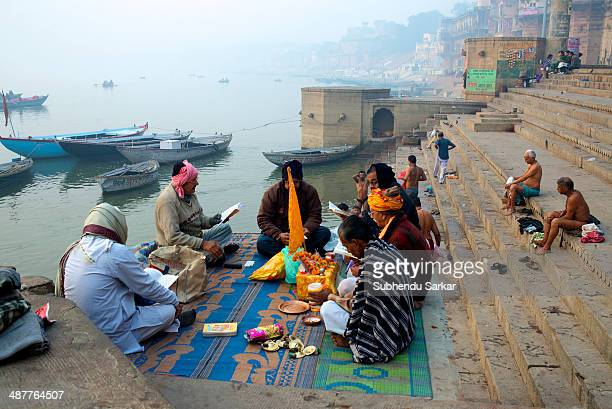 People engaged in religious ritual on the ghats of Varanasi Varanasi is a holy city on the banks of the Ganges