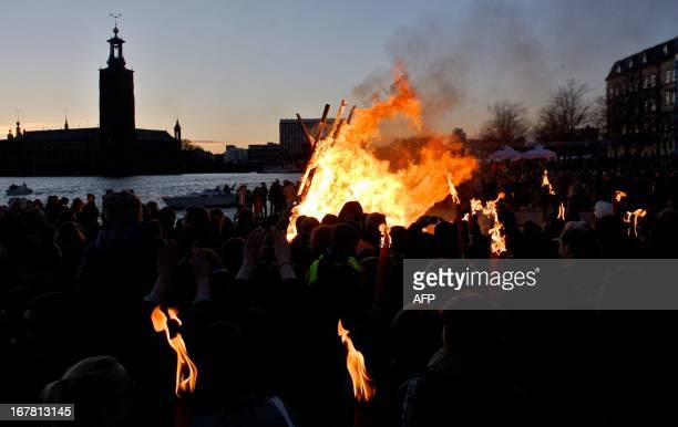 People enjoy a bonfire at Riddarholmen in Stockholm on April 30 celebrating Walpurgis Night the eve of May 1st Walpurgis Night is a nonreligious...
