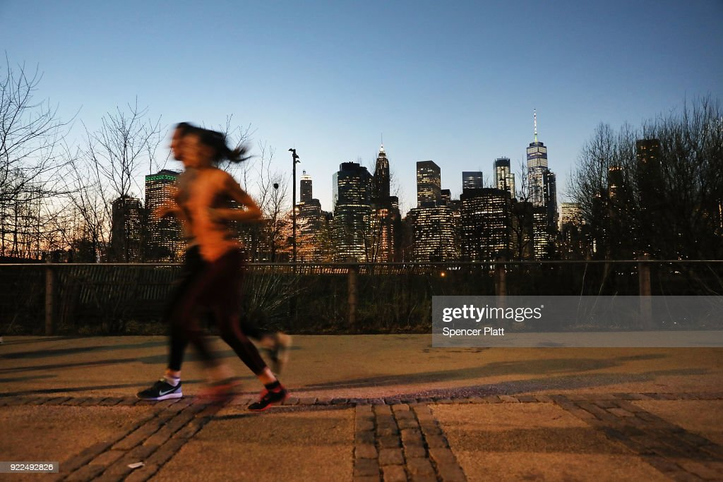 People enjoy a Brooklyn park after sunset on a day where temperatures reached near 70 degrees in New York City on February 21, 2018 in New York City. The weather will take a quick change back to winter on Thursday with temperatures expected in the high 30's by the end of the day.