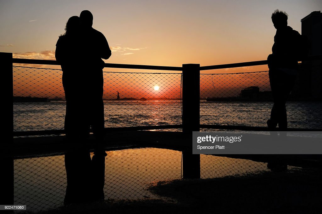 People enjoy a Brooklyn park as the sun sets on a day where temperatures reached near 70 degrees in New York City on February 21, 2018 in New York City. The weather will take a quick change back to winter on Thursday with temperatures expected in the high 30's by the end of the day.