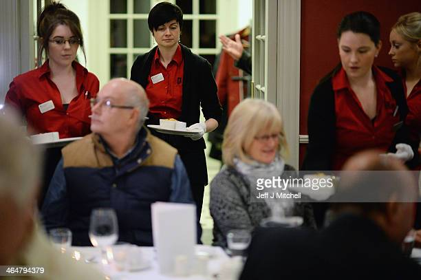 People enjoy a Burns supper in the red room at Burns Cottage Pavilion on January 23 2014 in Alloway Scotland People around the world will mark the...