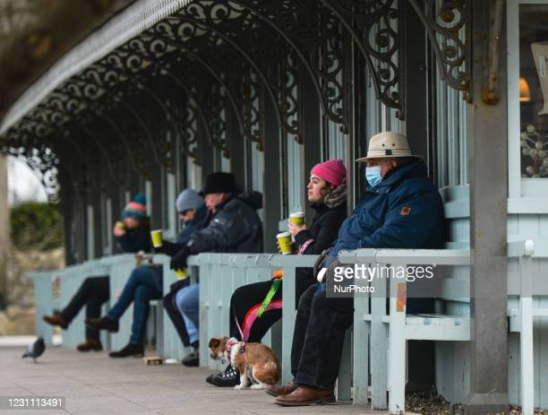 People enjoy a coffee outside Fallon and Byrne story in People's Park, Dún Laoghaire area of Dublin, during Level 5 Covid-19 lockdown. On Thursday,...