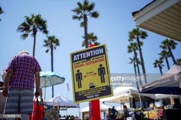 People enjoy a crisp Summer day near the Huntington Beach Pier, on Friday, Sept. 4, 2020 in Huntington Beach, CA. As California braces for a looming...