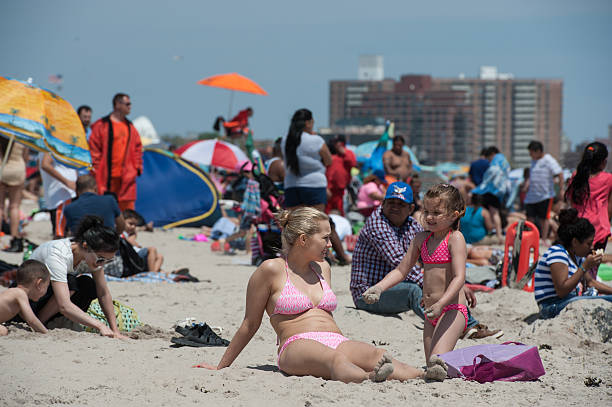 People Enjoy A Day At The Beach In Coney Island On May 29 2016