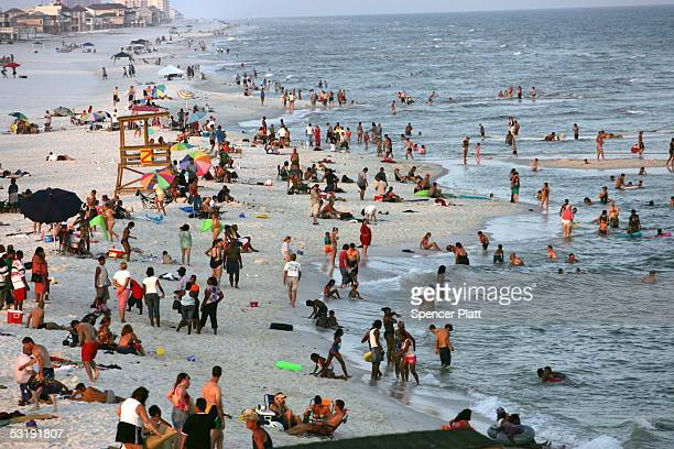 People enjoy a day at the beach July 3 2005 in Pensacola Florida Florida has experienced a recent spate of shark attacks with three in the last week...