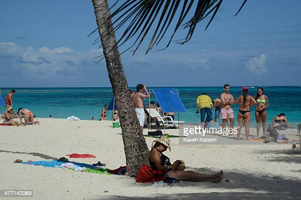 People enjoy a day on the sandy beach on January 26 2014 in San Andres Colombia Colombia has a territorial dispute with Nicaragua regarding San...