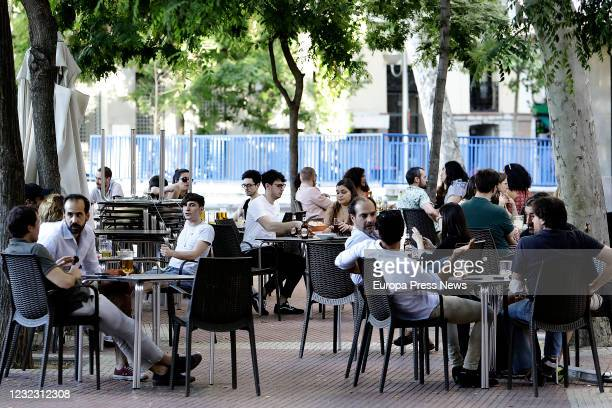 People enjoy a drink at a terrace in the square of Olavide during the fourth day of phase one on May 28 in Madrid Spain All regions of Spain have now...