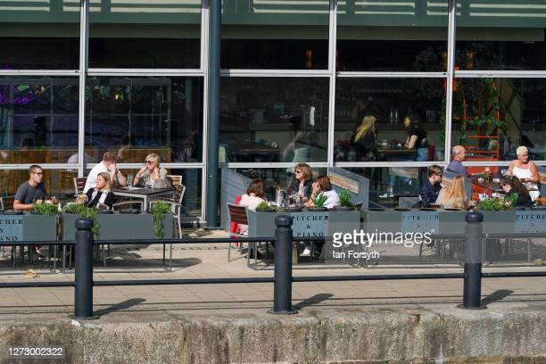 People enjoy a drink in the sunshine at a pub on Newcastle quayside on September 17 2020 in Newcastle upon Tyne England Almost two million people in...