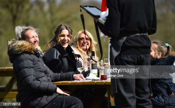 People enjoy a drink whilst in a beer garden at Hotel Rudyard on April 12, 2021 in Leek, England. England has taken a significant step in easing its...