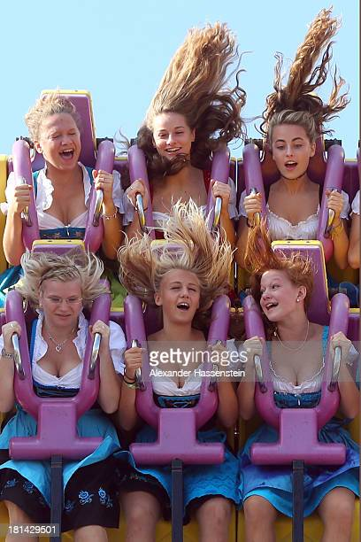 People enjoy a fairground ride during day 1 of the Oktoberfest 2013 beer festival at Theresienwiese on September 21 2013 in Munich Germany The Munich...