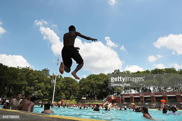 People enjoy a hot afternoon at the Astoria Pool in the borough of Queens on the opening day of city pools on June 29 2016 in New York CityThe main...