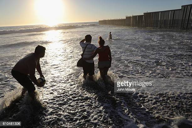 People enjoy a late afternoon near the USMexico border fence on September 25 2016 in Tijuana Mexico Friendship Park located on the border between the...