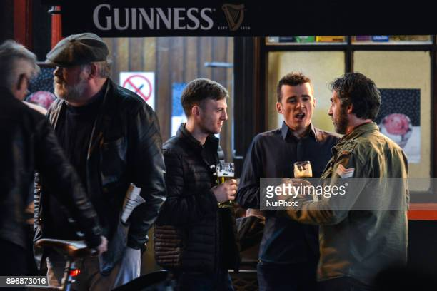 People enjoy a pint and chat outside J Grogan pub in Dublin city center just days ahead of Christmas The 12 Pubs of Christmas has become an annual...