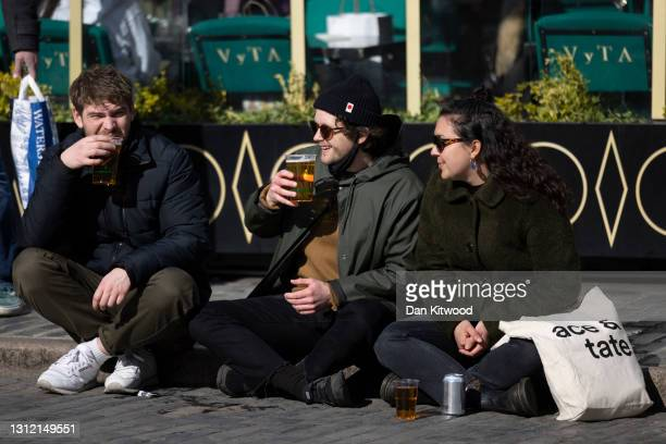 People enjoy a pint in the sunshine in Covent Garden on April 12, 2021 in London, United Kingdom. England has taken a significant step in easing its...