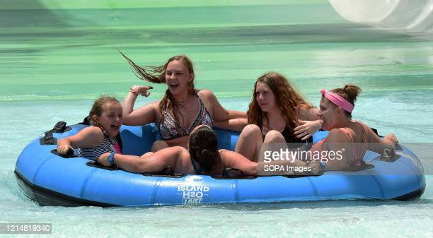 People enjoy a raft ride at Island H2O Live water park as the attraction becomes the only major water park in the Orlando area to reopen for Memorial...