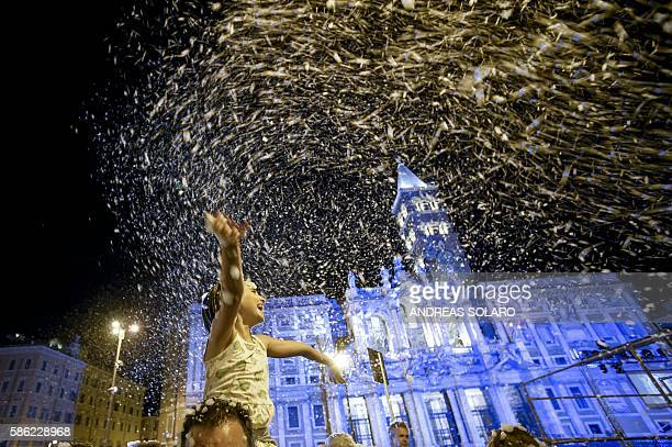People enjoy a snowfall soap as they take part in the historical reenactment of the the miracle of summer snow in front of the Basilica of Santa...