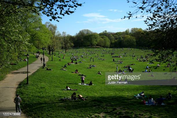 People enjoy a spring day during the coronavirus pandemic at Prospect Park on May 02, 2020 in the Brooklyn borough of New York City. New York City...