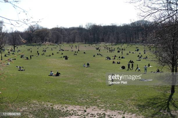 People enjoy a spring day in Prospect Park on March 21, 2020 in the Brooklyn borough of New York City. Despite the continued threat of the...