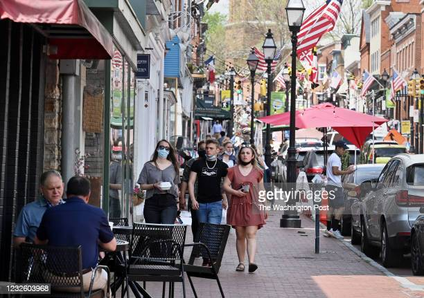People enjoy a stroll through Historic Annapolis Main Street in Annapolis , Maryland on April 29, 2021. Maryland Governor Hogan has lifted some of...