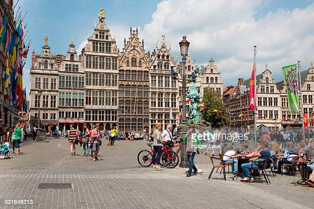 People enjoy a sunny afternoon at Grote Markt