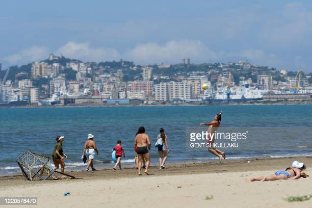 People enjoy a sunny day at a beach in Durres on June 10, 2020 as Albania reopen beaches after weeks of lockdown due to the spread of the COVID-19. -...