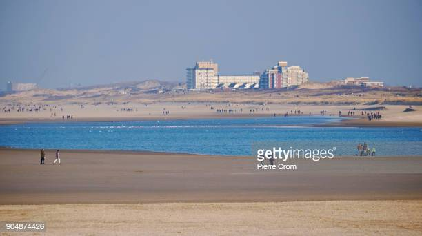 People enjoy a sunny day on the beach on January 14 2018 in The Hague Netherlands A sea level record has been measured in 2017 and Marine Institute...
