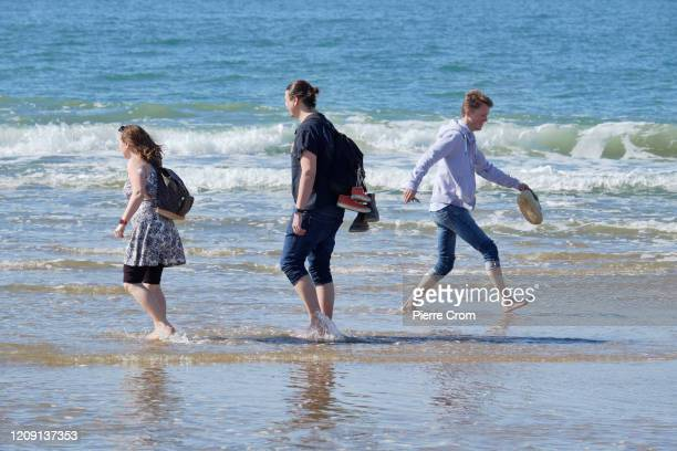 People enjoy a sunny day on The Hague beach amid the coronavirus pandemic on April 4 2020 in The Hague The Netherlands The number of confirmed...