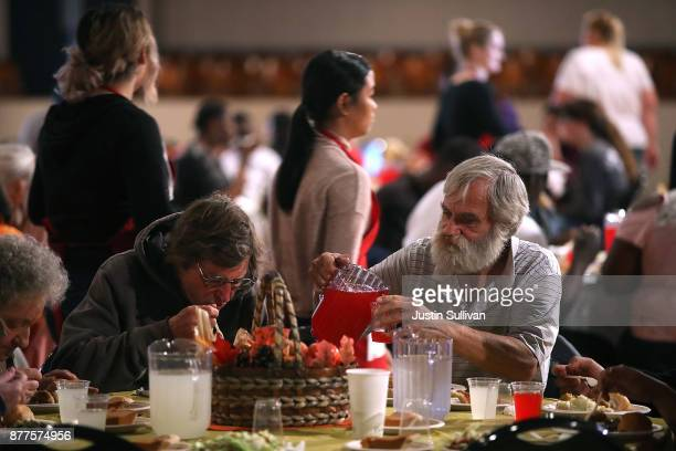 People enjoy a Thanksgiving meal during the Great Thanksgiving Banquet hosted by the Bay Area Rescue Mission on November 22, 2017 in Richmond,...