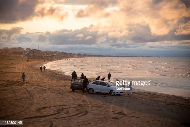 People enjoy a visit at the beach during the Persian New Year holidays in Bandar-e Anzali, Gilan province, Iran, 21 March 2019.
