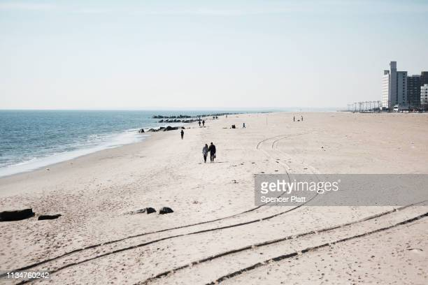 People enjoy a warm afternoon at New York's Coney Island on March 09 2019 in New York City Following a cold and windy week crowds of families and...