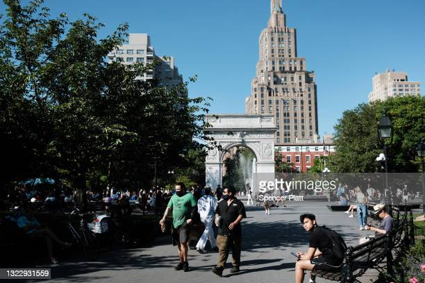 People enjoy a warm afternoon in Manhattan's Washington Square Park on June 10, 2021 in New York City. As New York City emerges from the Covid-19...