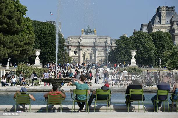 People enjoy a warm and sunny day at the Jardin des Tuileries garden on June 18 2014 in Paris AFP PHOTO / MIGUEL MEDINA