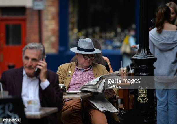 People enjoy afternoon in the cafe in Temple Bar area of Dublin. On Wednesday, 07 July 2021, in Dublin, Ireland.
