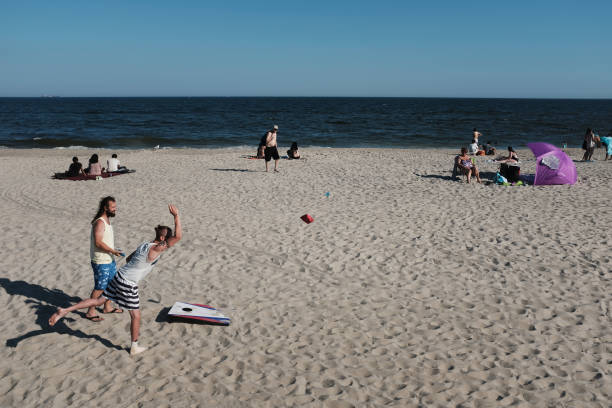 NY: New Yorkers Head To The Beach As Schools Start Summer Vacation