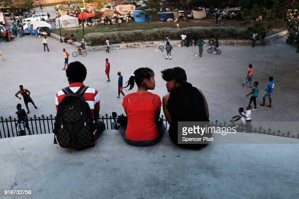 People enjoy an afternoon in a park in Port au Prince on February 10 2018 in PortauPrince Haiti Haiti the poorest country in the Western Hemisphere...