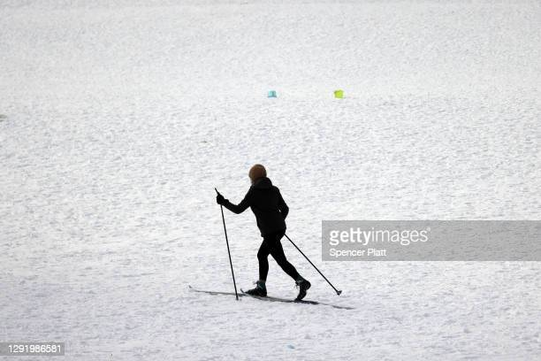 People enjoy an afternoon in Prospect Park in Brooklyn following a winter storm that brought nearly a foot of snow to parts of the city on December...