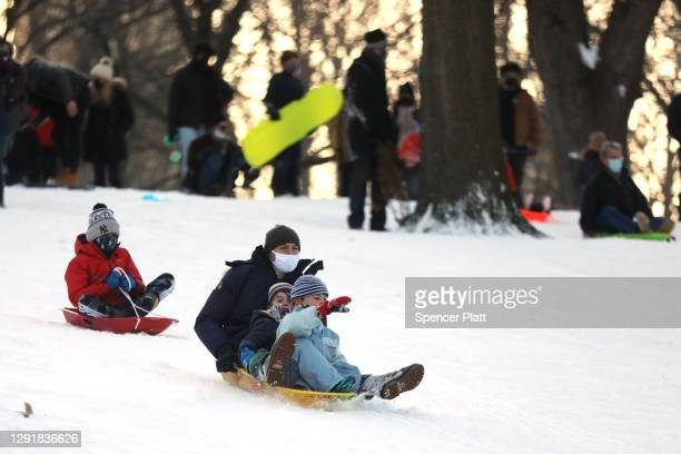 People enjoy an afternoon of sledding at Central Park in Manhattan on December 17, 2020 in New York City. New York City received 6 to 8 inches of...