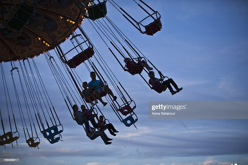 People enjoy an amusement park ride at Point Pleasant Beach on the first weekend of New Jersey beaches re-opening to the public on May 27, 2013 in Point Pleasant, New Jersey. The region continues to recover and rebuild after Hurricane Sandy devastated parts of the coastline.