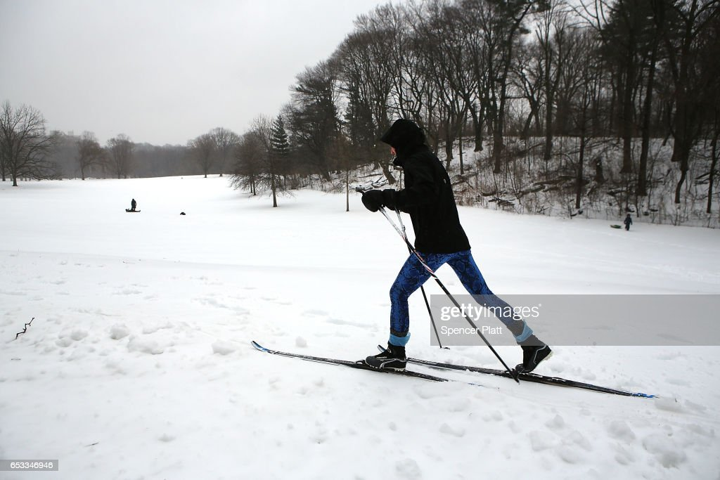 People enjoy and afternoon in the sleet and snow in Brooklyn's Prospect Park on March 14, 2017 in New York City. New York City and New Jersey experienced near blizzard conditions as the late winter storm brought up to seven inches of snow to the area. Schools, flights, businesses and public transportation are closed or restricted throughout the area.