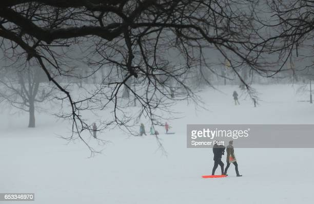 People enjoy and afternoon in the sleet and snow in Brooklyn's Prospect Park on March 14 2017 in New York City New York City and New Jersey...