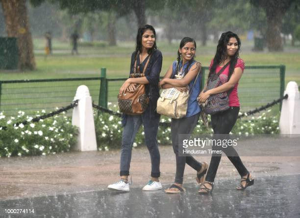 People take shelter under a flyover near ISBT Bus Terminal during rain on July 16 2018 in New Delhi India Heavy rains lashed parts of national...
