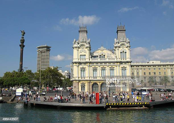 People enjoy at docks next Christovan Colombo Monument and building of Customs in Barcelona ,Spain. On September 30, 2010. Puerto de Barcelona has a...