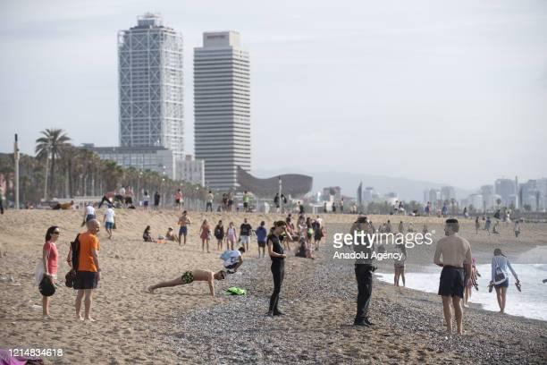 People enjoy at La Barceloneta Beach after Spain's starting a slow coronavirus lockdown in Barcelona, Spain on May 24, 2020.