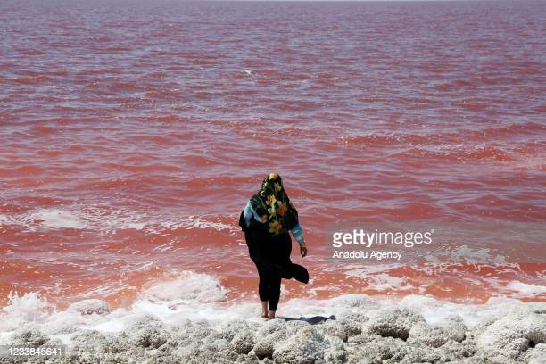 People enjoy at the Lake Urmia, one of the biggest saltwater lakes in the world located in the northwest of Iran, as it once again face a threat of...