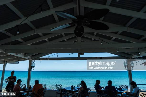 People enjoy brunch at Beach Side Cafe inside the Sand Castle on the Beach hotel on Sunday November 26 in Saint Croix Virgin Islands