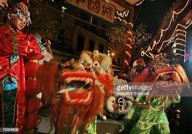 People enjoy Chinese Lion and Dragon dances in a street of Havanna 17 February 2007 on the occasion of the Chinese Lunar New Year of the Pig The...