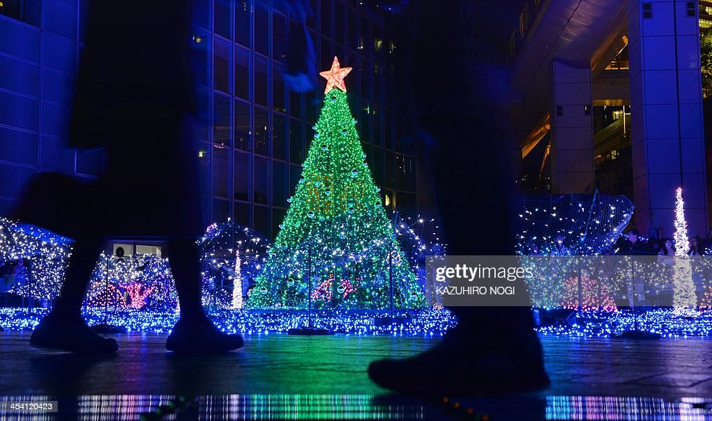 People enjoy Christmas illuminations featuring the theme of 'Christmas in the sea' in Tokyo's Shiodome on December 7, 2013. The Christmas illuminations will be displayed until 25 December.