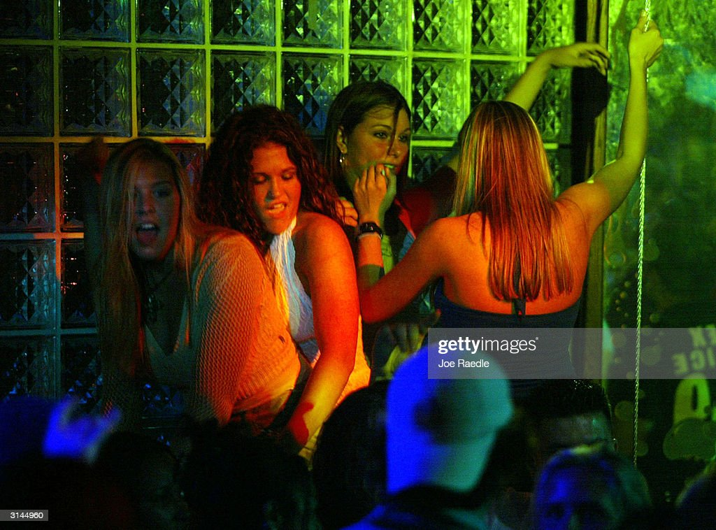 People enjoy dancing during spring break at 600 North night club March 26, 2004 in Daytona Beach, Florida. As spring break 2004 comes to a close the city is trying to rid itself of the image of years past with a new campaign called 'It's All About Respect' which is trying to curb the out of control partying that was indicative of spring breaks in Daytona Beach.