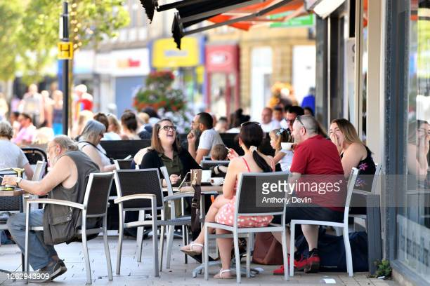 People enjoy dining outdoors in Burnley on July 31, 2020 in Burnley, England. Lockdown has been heightened in parts of England with a restriction ban...